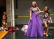 Katie Hitchens practices walking in her evening gown and heels while her older sister Abbey acts as her escort on stage. Both sisters will be competing in the Miss Ohio Outstanding Teen pageant.