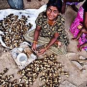Children work from homes as a contract worker making the paper substances used in Fireworks Industry. Image © Balaji Maheshwar/Falcon Photo Agency