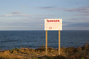danger sign on a cliff in Montauk by the ocean