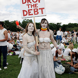 MAKE POVERTY HISTORY Two young protesters contribute to the campaign effort all in White! .Date picture taken 2nd July Edingburgh make poverty history Rally. photo published in The Newstatesman 11july 2005