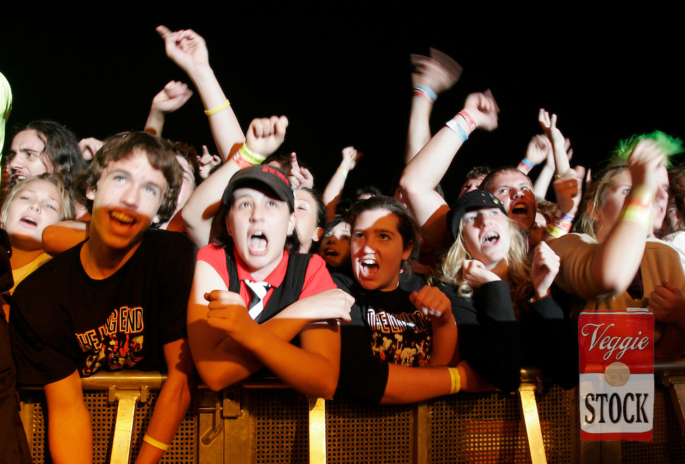 Teens watch Australian punk band The Living End perform at the Great Escape music festival in Sydney, Sunday, April 8, 2007. The festival is in its second year and runs over the Easter long weekend. (AAP Image/Megan Young) NO ARCHIVING
