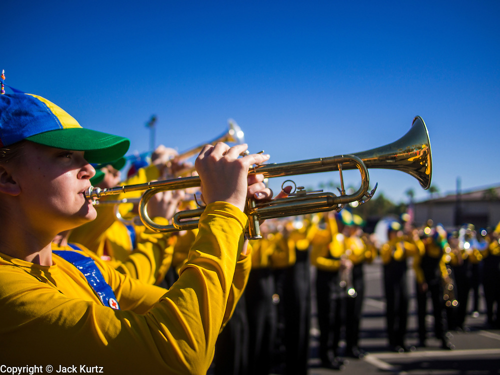 """11 NOVEMBER 2013 - PHOENIX, AZ: Students from Sandra Day O'Connor High School participate in the Phoenix Veterans Day Parade. The Phoenix Veterans Day Parade is one of the largest in the United States. Thousands of people line the 3.5 mile parade route and more than 85 units participate in the parade. The theme of this year's parade is """"saluting America's veterans.""""    PHOTO BY JACK KURTZ"""