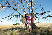 The Reilly kid's with friends. Left to right, Ben McNee, James Reilly (in tree), Pippa Reilly and Kiri-Lee Ward, on the Reilly family wheat farm. Wyalkatchem, Western Australian Wheatbelt. 09 December 2012 - Photograph by David Dare Parker