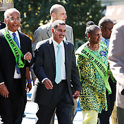 New York Governor David Paterson -- flanked by NYC Comptroller Bill Thompson and Executive Director of DC37 Lillian Roberts -- walks in the 40th Annual African Day Parade on September 20, 2009.
