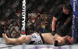 Atlanta, GA - April 21, 2012: Chad Griggs lies motionless after being choked out by Travis Browne during their bout at UFC 145 at the Phillips Arena in Atlanta, Georgia.