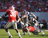 Ole Miss quarterback Bo Wallace (14) vs. Georgia defensive end Garrison Smith (56) at Sanford Stadium in Athens, Ga. on Saturday, November 3, 2012.