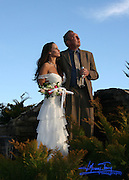 A bride and groom looking towards their happy future together on top of a mountain in Blue Ridge Georgia.