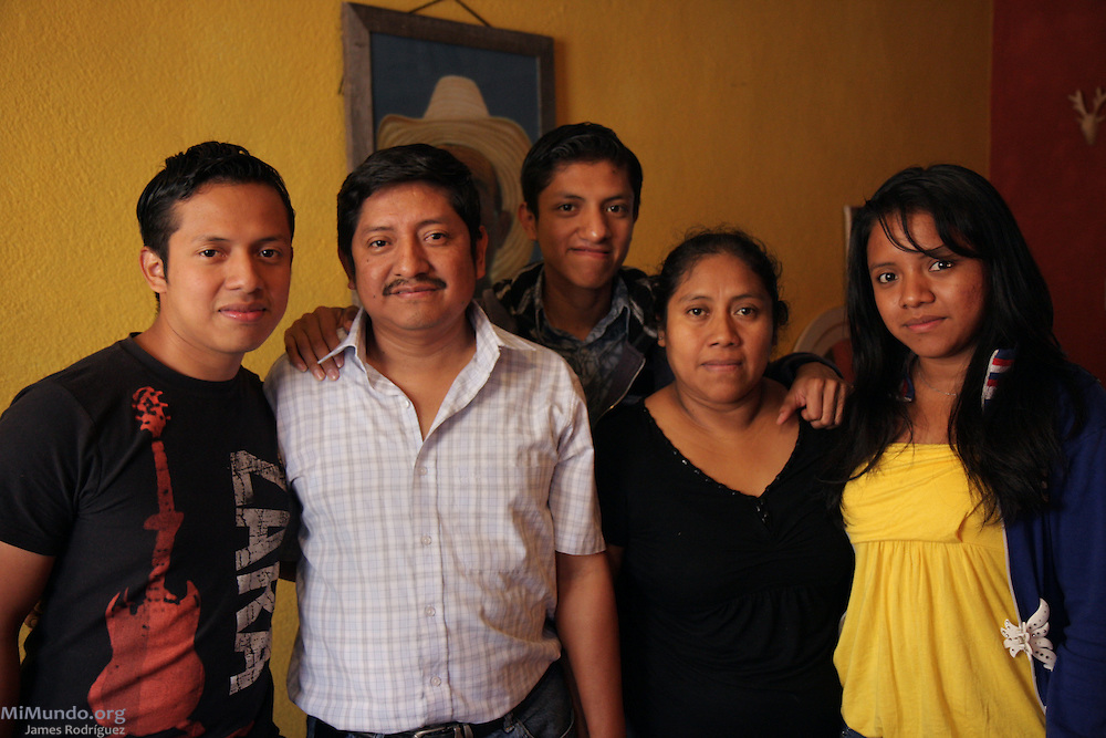 Leocadio Juracan (2nd from left), poses for a family portrait with his wife and children hours before fleeing Guatemala following a series of death threats against them. Leocadio Juracan is a well known labor, peasant and indigenous rights advocate and director of the Campesino Committee of the Highlands (CCDA, in Spanish) that produces the well known Cafe Justicia coffee brand. The CCDA was founded in 1982 as an organization that works to defend the rights of workers on large coffee, sugar and cotton plantations, to recover lands taken from the Mayan communities over the past centuries, and to promote and recover Mayan culture and spirituality. Today about 100 communities in 11 Guatemalan provinces are affiliated to the CCDA, but the organization is strongest in the Madre Vieja valley of Sololá. Guatemala City, Guatemala. February 19, 2010.