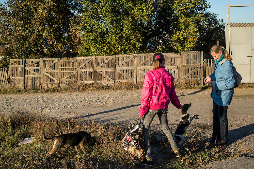 DNIPROPETROVSK, UKRAINE - OCTOBER 12: Yeva, 10, and her grandmother, Svitlana Kostromina, walk from the Good News Evangelical Church to the home where they are living with a family that is part of the congregation on October 12, 2014 in Dnipropetrovsk, Ukraine. Yeva and her family fled fighting in Luhansk. The United Nations has registered more than 360,000 people who have been forced to leave their homes due to fighting in the East, though the true number is believed to be much higher.(Photo by Brendan Hoffman/Getty Images) *** Local Caption *** Svitlana Kostromina