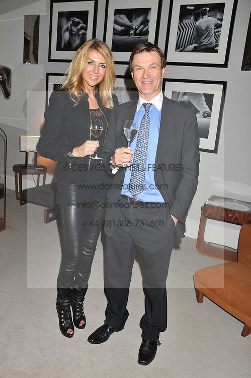 A reception in honour of David Linley to recognise his ambassadorial role for Ruinart Champagne held at Linley, Pimlico Road, London on 24th October 2012.<br /> Picture shows:-ROLAND &amp; COLETTE FOX.