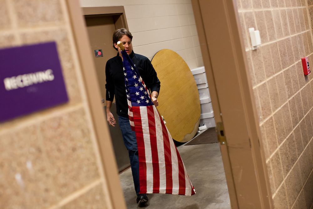 John Kallen helps to prepare a caucus site at Summit Middle School on Tuesday, January 3, 2012 in Johnston, IA.
