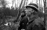 Farmers waiting with dog at the hunting place in the countryside of the Danish island Funen on sunday  17. November 2002.  Photo: Erik Luntang