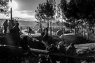 03 December 2015, Idomeni Greece - Refugees waiting to cross the Macedonian border.