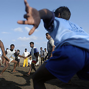 Unemployed fishermen from Chinnangudi, a 540-family fishing village in Tamil Nadu, India, play a traditional game of Kabaddi organized by volunteers from AID India on January 16, 2005, after the area was struck by the Indian Ocean Tsunami on December 26, 2004, killing 40 of the villagers and destroying nearly all of their fishing boats. Generated by an earthquake on the ocean floor, the tsunami devastated the fishing industry along the southeastern coast of India.