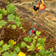 """Elaina Arenz climbing """"Trojans"""" 11c, Lower Meadow, The New River Gorge"""