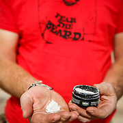 SHOT 10/17/16 10:34:39 AM - Tom Reynolds of Denver, Co. prepares to spread the ashes of friend Doug Pensinger near Musselman Arch on the White Rim Trail. The White Rim is a mountain biking trip in Canyonlands National Park just outside of Moab, Utah. The White Rim Road is a 71.2-mile-long unpaved four-wheel drive road that traverses the top of the White Rim Sandstone formation below the Island in the Sky mesa of Canyonlands National Park in southern Utah in the United States. The road was constructed in the 1950s by the Atomic Energy Commission to provide access for individual prospectors intent on mining uranium deposits for use in nuclear weapons production during the Cold War. Four-wheel drive vehicles and mountain bikes are the most common modes of transport though horseback riding and hiking are also permitted.<br /> (Photo by Marc Piscotty / &copy; 2016)