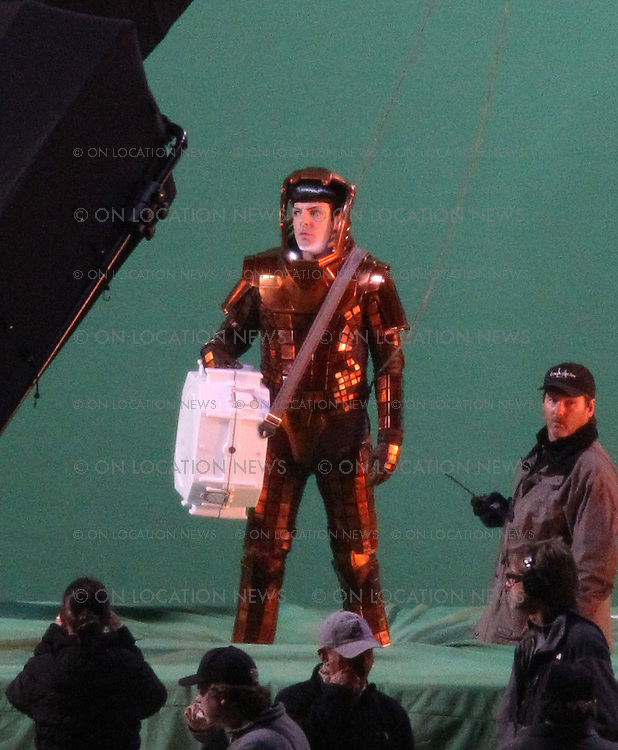 April 13th 2012 Los Angeles, CA  ***EXCLUSIVE*** <br /> Zachary Quinto as Spok filming an action scene for the Untitled Star Trek 2 Sequel. After first rehearsing the scene with a Spok Stunt Double Actor Zachary Quinto was then rigged to a wire in front of a large green screen and lifted to a height of 10 stories high then dropped at a high rate of speed as if he was falling. In the scene Spok is wearing a &quot;Volcano Suit&quot; and carrying an unknown piece of equipment with the  Starfleet  Emblem. A Volcano is somehow involved in this scene. The crew had a real fire burning off camera to catch the fire reflections on Spok's &quot;Volcano Suit&quot;. <br /> Photo by Eric Ford 818-613-3955 info@onlocationnews.com
