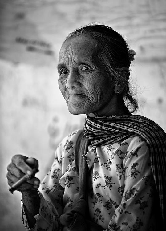 A woman smoking at a market on Inle lake, Myanmar.