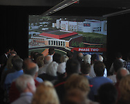 University of Mississippi athletic fans watch a presentation detailing a new basketball arena and an expansion to Vaught-Hemingway Stadium in Oxford, Miss. on Tuesday, August 9, 2011. The university announced a $150 million capital improvement campaign to build a new basketball arena and expand the football stadium. (AP Photo/Oxford Eagle, Bruce Newman)