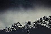 Patches of snow on a cloudy day in the Italian Alps - textured photograph
