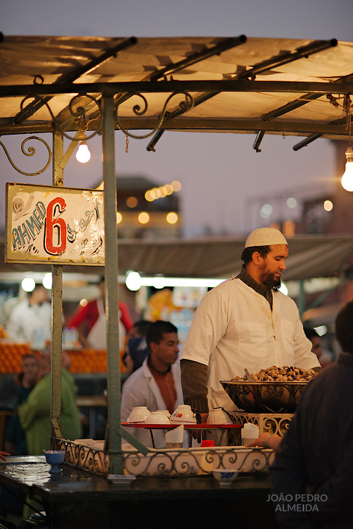 The food stands that fill the Jemaa el-Fnaa square at the end of the day, here the small stands serving bowls of cooked snails.