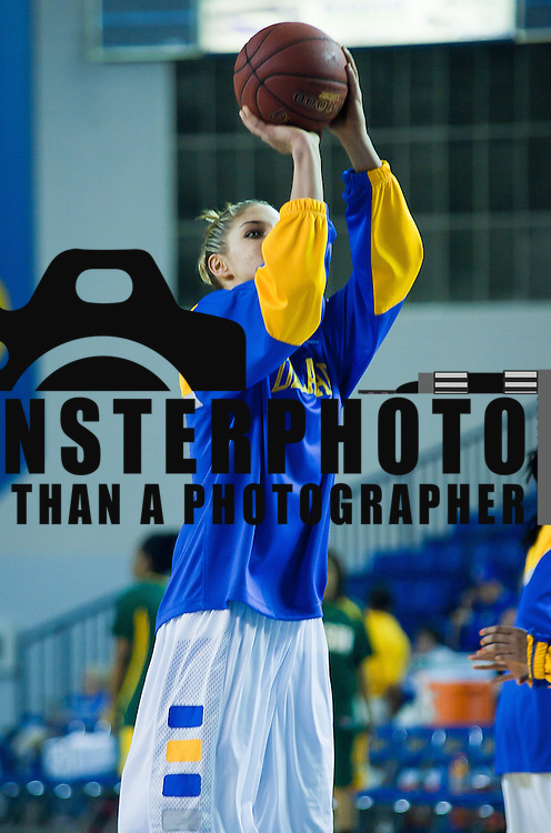 Delaware Junior Forward Elena Delle Donne (11) take a shot during warm up's prior the start of an NCAA college basketball game against The Lady Patriots of George Mason Thursday, Feb. 23, 2012 at the Bob Carpenter Center in Newark, Del. (AP Photo/Saquan Stimpson)