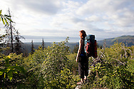 Stephanie Haynes looks out over Kachemak Bay towards Homer, Alaska while hiking on the Alpine Ridge trail in Kachemak Bay State Park.