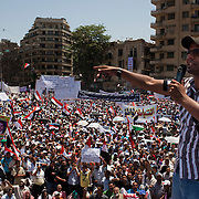 A political speaker leads tens of thousands of  Egyptians in chants during a large July 8, 2011 protest in Tahrir Square in downtown Cairo, Egypt. Many of the protesters have vowed to stay in the square until the demands of the revolution are met, including an end to military trials of civilians, prosecution of police officers accused of murder or torture and open trials of former regime officials including ex-President Hosni Mubarak. (Photo by Scott Nelson/Der Spiegel)