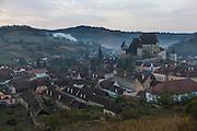 Rural village, Biertan, Romania, morning, wood smoke, valley, Romanian Orthodox Church.