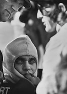 Francois Cevert knew the 1973 US Grand Prix was his chance to assert leadership of Team Tyrrell. His great friend and triple-world champion Jackie Stewart had told him of his intention to retire at the end of this Grand Prix.  <br /> <br /> He was on the cusp of an incredible future. <br /> <br /> Here, Francois is seen deeply lost in thought during morning practice, as Stewart and designer Derek Gardner discuss possible suspension adjustments. <br /> <br /> After this frame, I watched Francois blow a kiss to Jackie's wife, Helen, and head out onto the circuit. Two minutes later he was dead; a victim of a crash in the Watkins Glen Esses.<br /> <br /> Had Cevert survived, his talent and race craft would have allowed him to challenge for many World Championships with Tyrrell. He would have been the first French World Champion, and Grand Prix history might be far different now. <br /> <br /> Cevert had it all: fan appeal, sponsor skills and a successful apprenticeship with three-time world champ Jackie Stewart.<br /> <br /> As it was, great friend and teammate Jackie Stewart retired on the spot, and the Tyrrell team had its spirit broken nearly beyond repair. The team soldiered on in 1974 with new drivers Jody Sheckter and Patrick Depailler, but the die was cast. The Tyrrelll team would slowly fade, leaving the Formula One championship in 1998.