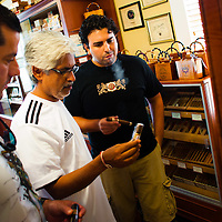 TAMPA, FL -- July 2012 -- Patrick Gore of Tampa, left, to right, Dhaval Shukla of Kentucky and sales director Josh Fabelo check out the stock at the Tampa Sweetheart Cigar Company in Ybor City. (PHOTO /CHIP LITHERLAND)
