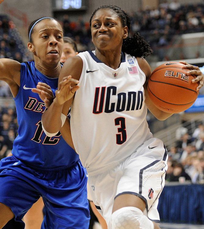 Connecticut's Tiffany Hayes is guarded by DePaul's China Threatt during the second half of an NCAA college basketball game, in Storrs, Conn., Saturday, Feb. 5, 2011. (AP Photo/Jessica Hill)