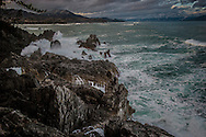 An angry winter storm clears from the Kawakuwa Peninsula between Kesenuma and Rikuzen-Takata.  Miyagi Prefecture, Japan<br /> <br /> Legend has it that the name Karakuwa (唐桑) means &quot;China&quot; (during the Tang Dynasty) &quot;mulberry&quot; because centuries ago a Chinese ship wrecked on the coast which is easy to imagine looking out on these high seas.  Part of the cargo was a mulberry tree.  The tree was rescued, then planted, and soon mulberry trees common became to the area.