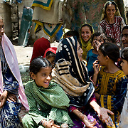 A family member making a family visit to Mirzada's home shares the latest gossip with her family members. <br /> Most people in Pakistan live in a joint family system. <br /> Women take care of the households and raise the children at home. Elderly people heavily rely on their children and grandchildren to provide for them when they get older. Karachi, Pakistan