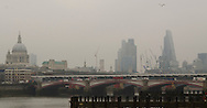 The City of London Skyline during today's Eclipse Approx 09.11), London, Britain - 20-Mar 2015.