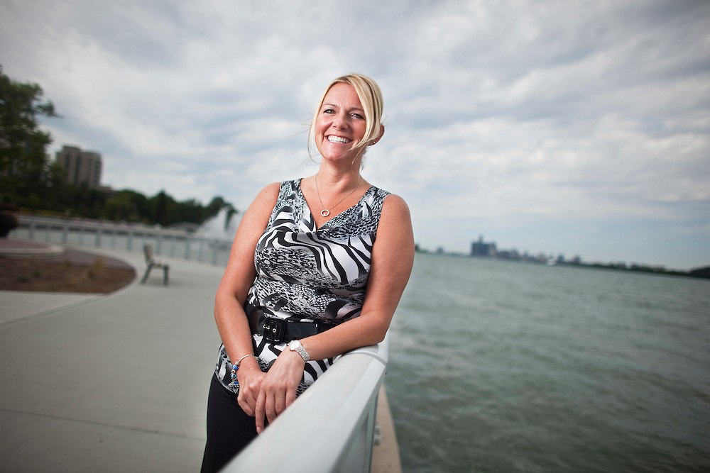 Windsor, Ontario ---11-08-21--- Krista Delgatto, executive officer of the Windsor-Essex County Board of Realtors stands on the banks of the Detroit River in Windsor, Ontario, August 21, 2011. <br /> GEOFF ROBINS The Globe and Mail