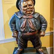 """This image of Jack Tar first appeared after 1841, when the US Navy regulated its uniforms for the first time, with shore leave uniform of open jacket, red neckerchief, black shoes, and black brimmed hat. This """"Jack Tar, Mid-19th century"""" carved and painted wood trade sign originally stood outside a San Francisco ships' chandler shop, which sold navigational instruments and naval supplies. It was later used as a cigar store figure in San Jose, California. Hats water-proofed with tar or dark paint gave the ordinary sailor the nickname """"Jack Tar."""" Shelburne Museum is one of the finest, most diverse, unconventional museums of American folk art. Visit this extensive museum in the town of Shelburne, near Lake Champlain, in Vermont, USA. Over 150,000 works are exhibited in 38 buildings, 25 of which are historic (relocated from New England and New York). See impressionist paintings, American paintings, artifacts of the 1600s-1900s, folk art, quilts and textiles, carriages, furniture, a lighthouse, covered bridge, and 220-foot steamboat Ticonderoga. Electra Havemeyer Webb, an avid collector of American folk art, founded the Museum in 1947."""