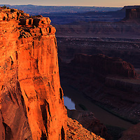 Warm light from the setting sun highlights Dead Horse Point over the Colorado River near Moab, Utah. WATERMARKS WILL NOT APPEAR ON PRINTS OR LICENSED IMAGES.