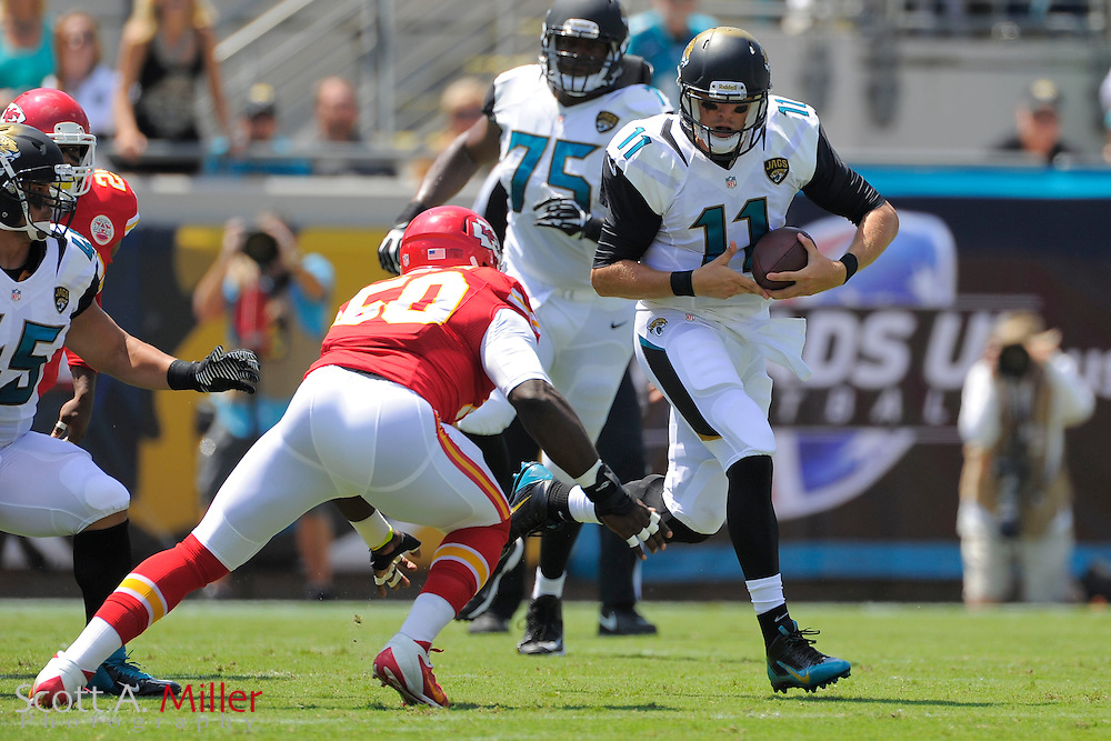 Jacksonville Jaguars quarterback Blaine Gabbert (11) tries to avoid a tackled by Kansas City Chiefs outside linebacker Justin Houston (50) during the Jags 28-2 loss to the Chiefs at EverBank Field on Sept. 8, 2013 in Jacksonville, Florida. The <br /> <br /> &copy;2013 Scott A. Miller