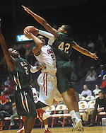"Ole Miss guard Trevor Gaskins (23) is fouled by Mississippi Valley State's Jason Holmes (42) as he drives past Mississippi Valley State's Cor-J Cox (21) at C.M. ""Tad"" Smith Coliseum in Oxford, Miss. on Monday, December 13, 2010."