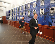 Ole Miss coach Houston Nutt walks to a news conference Monday Nov. 7, 2011 at the University of Mississippi in Oxford, Miss. Nutt will resign at the end of the season.