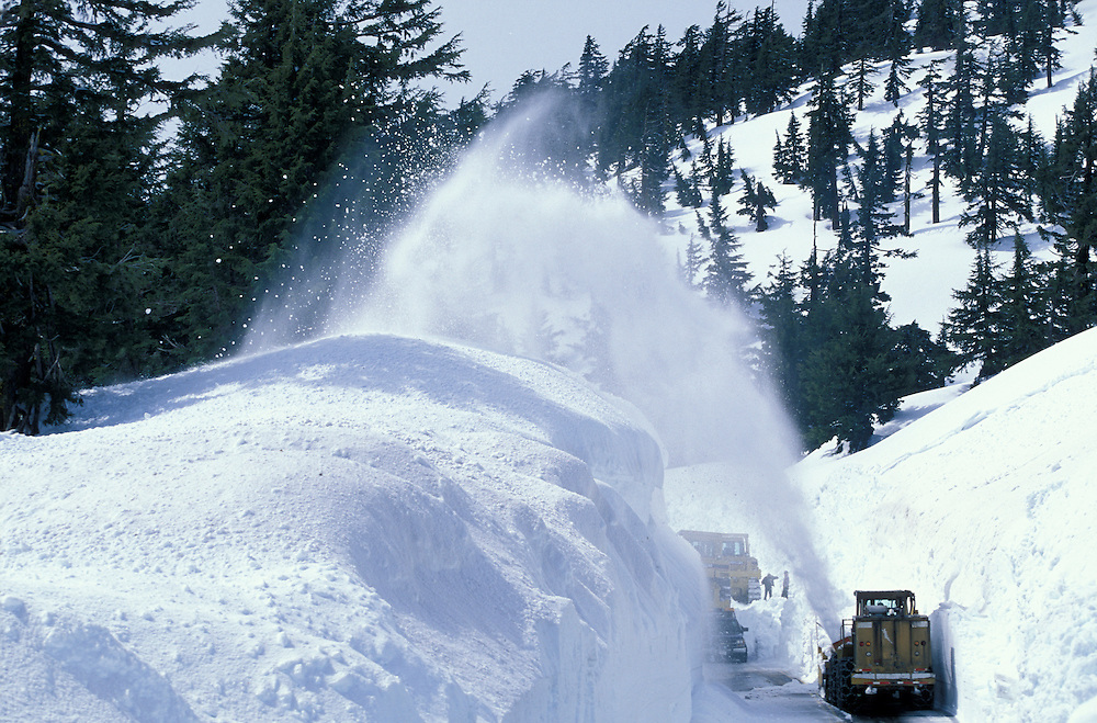 USA, Oregon, Crater Lake National Park, Snow plow struggles to clear deep snow from Rim Road surrounding Crater Lake