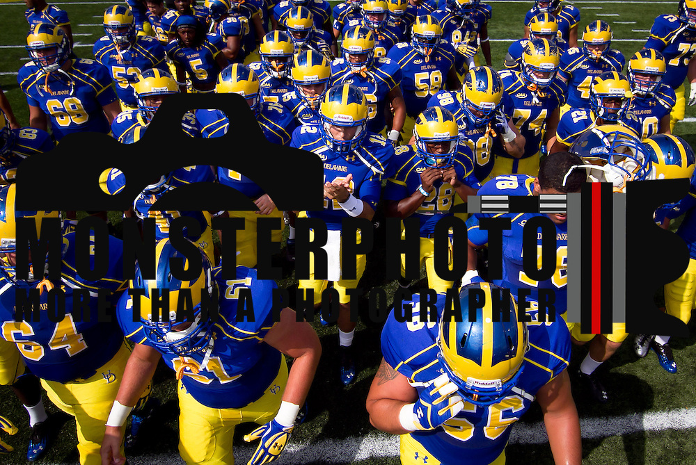 Delaware players return to the locker room after warm ups prior to a Week 2 NCAA football game against Delaware State #15 Delaware defeated Delaware State 28 -17 at Delaware Stadium Saturday Sept. 08, 2012 in Newark Delaware.