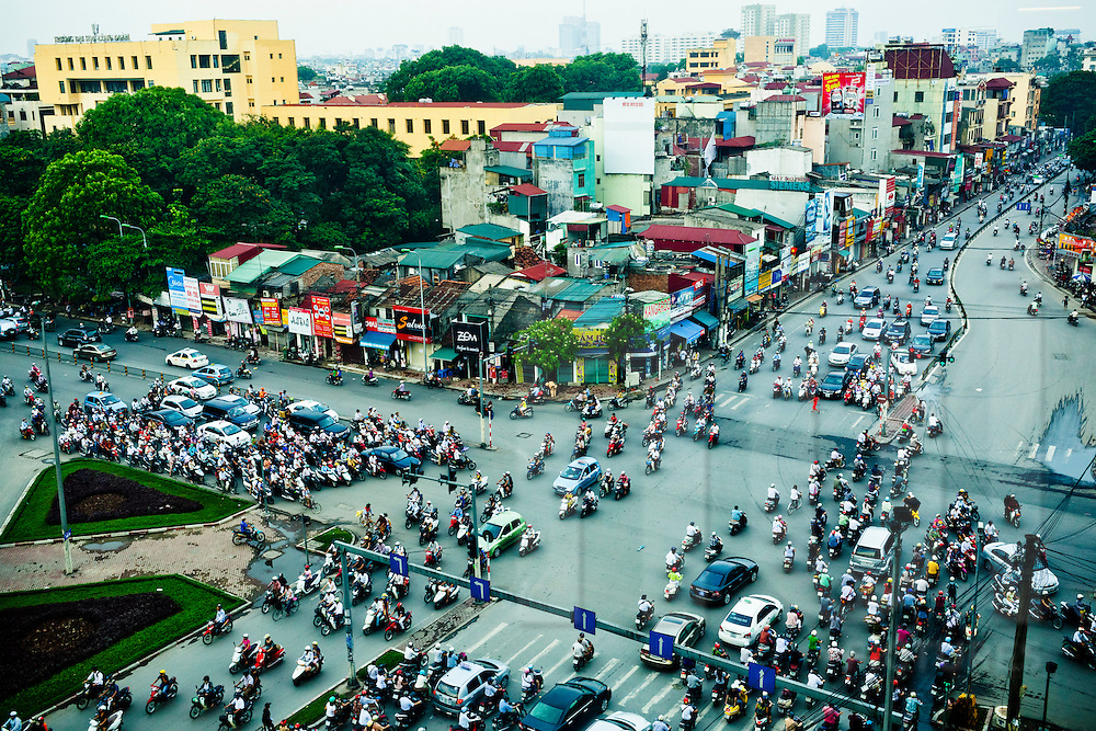 Hectic traffic at a crossroad of Hanoi during rush hour, Vietnam, Southeast Asia