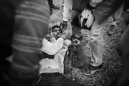 A man lays unconscious after being attacked by a mob inside Opatovac camp in Croatia. The military camp is used as a registration facility and transit camp for refugees on their way to Europe, Croatia.<br />