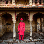 A Rajasthani man in traditional clothing poses during the Teej festival in Jaipur, Rajasthan, India.