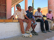 Men with duck in San Luis, Pinar del Rio, Cuba.