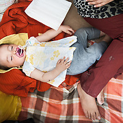 Mahdi 8 months old from Herat Afghanistan sleeps in his family's tent in Moria camp, Lesvos, Greece