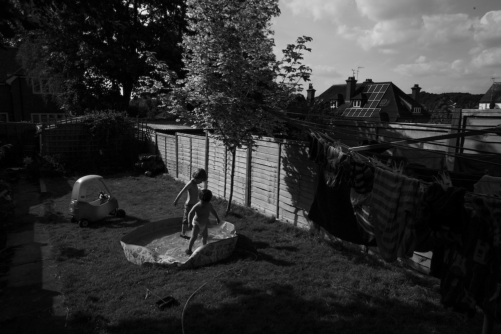 The boys play in their paddling pool in the back yard at home in Berkhamsted in England Tuesday, June 16, 2015 (Elizabeth Dalziel) #thesecretlifeofmothers #bringinguptheboys #dailylife