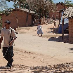 """A Community Police walks in the streets in El ParaÌso, in Ayutla de los Libres, na¥savi (mixteco) indigenous community. El ParaÌso is the newest headquarter of the Community Police (founded in 2012) and its the main flashpoint with other armed groups such as the self-called """"Autodefensas"""" (Self-Defenses) and paramilitary groups. / Un policÌa comunitario camina en las callesdel pueblo El ParaÌso, en Ayutla de los Libres, comunidad indÌgena na'savi o mixteco. El ParaÌso es la sede m·s reciente de la PolicÌa Comunitaria (fundado en 2012) y es el principal lugar de confrontaciÛn con otros grupos armados como los conocidos como Autodefensas y grupos paramilitares.  (Photo: Prometeo Lucero)"""